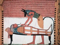 Wall painting of Anubis and a mummy