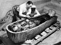 Photo of Howard Carter opening Tutankhamun's sarcophagus